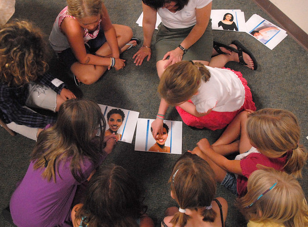 Girls in the self esteem workshop led by Gracie Forrey discuss altered photos by the fashion industry on Tuesday at Broomfield United Methodist Church.<br /> July 26, 2011<br /> staff photo/ David R. Jennings