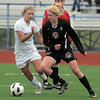 Broomfield's Morgan Rynearson moves in against Lewis-Palmer's Lindsey Ryals during Saturday's state playoff game at Elizabeth Kennedy Stadium.<br /> May 14, 2011<br /> staff photo/David R. Jennings