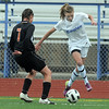 Broomfield's Brittney Stark takes control of the ball from Lewis-Palmer's Laura Regnier during Saturday's state playoff game at Elizabeth Kennedy Stadium.<br /> May 14, 2011<br /> staff photo/David R. Jennings