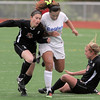 Broomfield's Hayli LaBadie collides with Lewis-Palmer's Jenny Healy, left, and Stacie Loidolt during Saturday's state playoff game at Elizabeth Kennedy Stadium.<br /> May 14, 2011<br /> staff photo/David R. Jennings