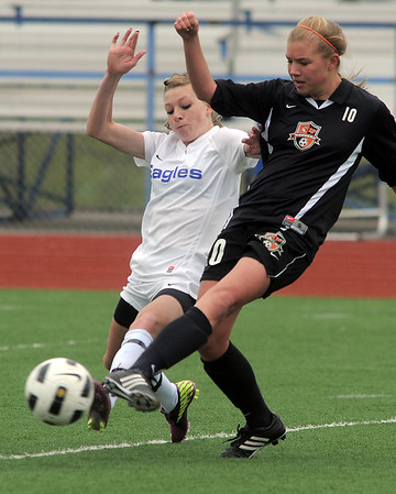 Broomfield's Brittney Stark goes toe to toe with Lewis-Palmer's Stacie Loidolt during Saturday's state playoff game at Elizabeth Kennedy Stadium.<br /> May 14, 2011<br /> staff photo/David R. Jennings