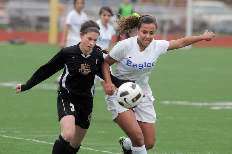 Broomfield's Hayli LaBadie fights for control of the ball against Lewis-Palmer's Jenny Healy during Saturday's state playoff game at Elizabeth Kennedy Stadium.<br /> May 14, 2011<br /> staff photo/David R. Jennings