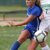 Broomfield's Hailey Mazzola moves the ball away from Niwot's Lauren Tatusko during Thursday's game at Niwot.<br /> <br /> April 19, 2012 <br /> staff photo/ David R. Jennings