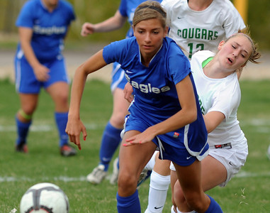 Broomfield's Chaya Ahrens goes after the ball against Niwot's Lauren Tatusko during Thursday's game at Niwot.  April 19, 2012  staff photo/ David R. Jennings