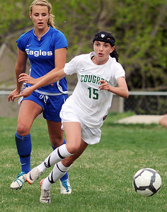 Niwot's Maria Fayeulle moves the ball against Broomfield's Hailey Mazzola during Thursday's game at Niwot.  April 19, 2012  staff photo/ David R. Jennings