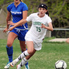 Niwot's Maria Fayeulle moves the ball against Broomfield's Hailey Mazzola during Thursday's game at Niwot.<br /> <br /> April 19, 2012 <br /> staff photo/ David R. Jennings