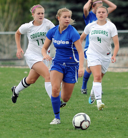 Broomfield's Morgan Rynearson advances the ball down field against Niwot during Thursday's game at Niwot.<br /> <br /> April 19, 2012 <br /> staff photo/ David R. Jennings