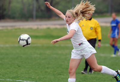 Niwot's Callie Hensen moves the ball down field against Broomfield during Thursday's game at Niwot.  April 19, 2012  staff photo/ David R. Jennings