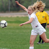 Niwot's Callie Hensen moves the ball down field against Broomfield during Thursday's game at Niwot.<br /> <br /> April 19, 2012 <br /> staff photo/ David R. Jennings