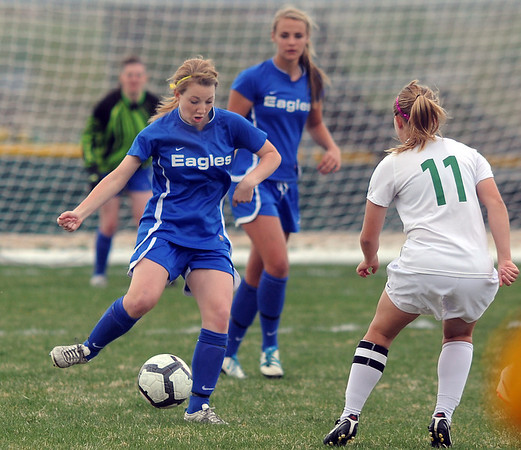 Broomfield's Patricia Finnegan kicks the ball against Niwot's Kylie Fischer during Thursday's game at Niwot.<br /> <br /> April 19, 2012 <br /> staff photo/ David R. Jennings