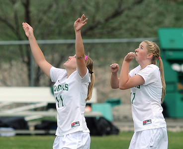 Niwot's Kylie Fischer, left, and Mickey Cramer eye a high kick during Thursday's game against Broomfield at Niwot.  April 19, 2012  staff photo/ David R. Jennings