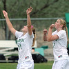 Niwot's Kylie Fischer, left, and Mickey Cramer eye a high kick during Thursday's game against Broomfield at Niwot.<br /> <br /> April 19, 2012 <br /> staff photo/ David R. Jennings