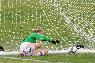The ball slips by Niwot's Kim Schoep into the net scpring a Broomfield goal during Thursday's game at Niwot.  April 19, 2012  staff photo/ David R. Jennings