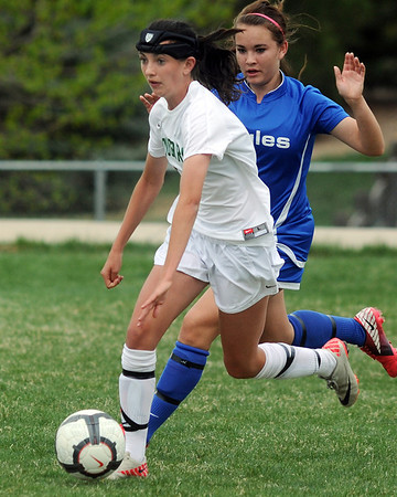 Niwot's Maria Fayeulle advances the ball downfield against Broomfield during Thursday's game at Niwot.<br /> <br /> April 19, 2012 <br /> staff photo/ David R. Jennings