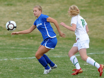 Broomfield's Morgan Rynearson goes after the ball against Niwot's Mickey Cramer during Thursday's game at Niwot.  April 19, 2012  staff photo/ David R. Jennings