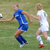 Broomfield's Morgan Rynearson goes after the ball against Niwot's Mickey Cramer during Thursday's game at Niwot.<br /> <br /> April 19, 2012 <br /> staff photo/ David R. Jennings