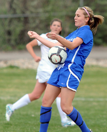 Broomfield's Courtney Miknis takes control of the ball against Niwot during Thursday's game at Niwot.<br /> <br /> April 19, 2012 <br /> staff photo/ David R. Jennings