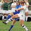 Broomfield's Morgan Rynearson kicks the ball past Niwot's Madison Studebaker during Thursday's game at Niwot.<br /> <br /> April 19, 2012 <br /> staff photo/ David R. Jennings