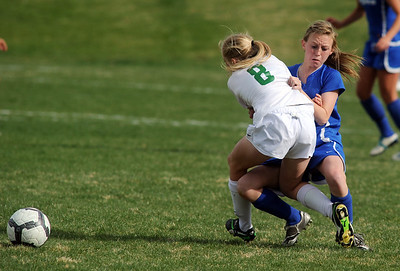 Niwot's Shannon Fischer, left, and Broomfield's Stephanie Martella collide during Thursday's game at Niwot.  April 19, 2012  staff photo/ David R. Jennings
