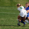 Niwot's Shannon Fischer, left, and Broomfield's Stephanie Martella collide during Thursday's game at Niwot.<br /> <br /> April 19, 2012 <br /> staff photo/ David R. Jennings