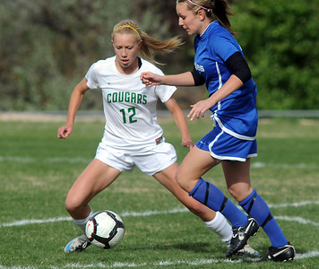 Niwot's Hannah Driscoll fights for control of the ball with Broomfield's Courtney Miknis during Thursday's game at Niwot.  April 19, 2012  staff photo/ David R. Jennings