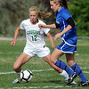Niwot's Hannah Driscoll fights for control of the ball with Broomfield's Courtney Miknis during Thursday's game at Niwot.<br /> <br /> April 19, 2012 <br /> staff photo/ David R. Jennings