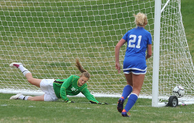 Broomfield's Sara Barton watches the ball slip past Niwot's Kim Schoep to score a goal during Thursday's game at Niwot.  April 19, 2012  staff photo/ David R. Jennings