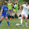 Niwot's Lauren FitzGibbons moves the ball past Broomfield's Kerri Marquardt during Thursday's game at Niwot.<br /> <br /> April 19, 2012 <br /> staff photo/ David R. Jennings
