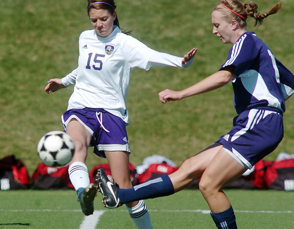 Holy Family's Maddie Kuzik blocks the ball from Kent Denver's Alex Jankovsky during Saturday's game at the Broomfield County Commons Park.<br /> April 30, 2011<br /> staff photo/David R. Jennings