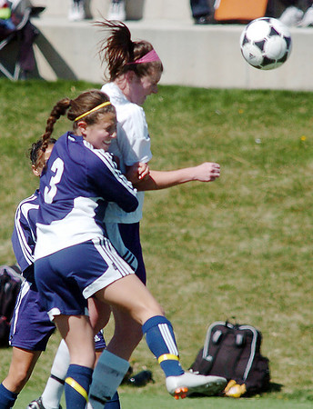 Holy Family's Abby Metzger does a header past Kent Denver's Aubrie Pike during Saturday's game at the Broomfield County Commons Park.<br /> April 30, 2011<br /> staff photo/David R. Jennings