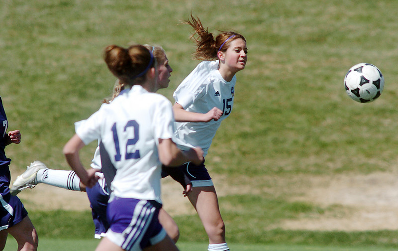 Holy Family's Maddie Kuzik moves the ball downfield against Kent Denver during Saturday's game at the Broomfield County Commons Park.<br /> April 30, 2011<br /> staff photo/David R. Jennings