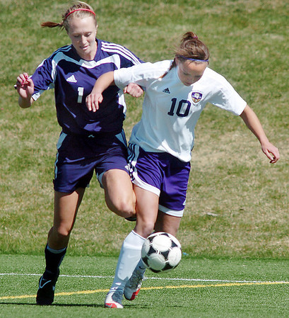 Holy Family's Meghan Jonikas takes control of the ball from Kent Denver's Alex Jankovsky during Saturday's game at the Broomfield County Commons Park.<br /> April 30, 2011<br /> staff photo/David R. Jennings