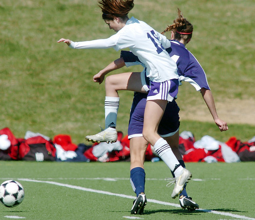 Holy Family's Maddie Kuzik collides with Kent Denver's Alex Jankovsky during Saturday's game at the Broomfield County Commons Park.<br /> April 30, 2011<br /> staff photo/David R. Jennings