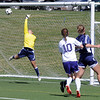 Holy Family's Meghan Jonikas watches as the ball goes past Kent Denver's  goalie Haley Kraus to score a goal during Saturday's game at the Broomfield County Commons Park.<br /> April 30, 2011<br /> staff photo/David R. Jennings