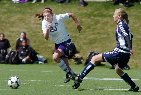 Holy Family's Abby Metzger charges towards the ball against Kent Denver's Catherine Sheehan during Saturday's game at the Broomfield County Commons Park.<br /> April 30, 2011<br /> staff photo/David R. Jennings
