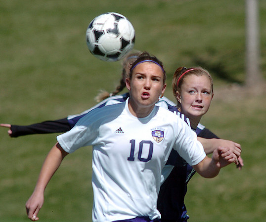 Holy Family's Meghan Jonikas fights for the ball against Kent Denver's Ellie Toll during Saturday's game at the Broomfield County Commons Park.<br /> April 30, 2011<br /> staff photo/David R. Jennings