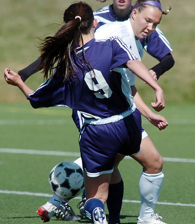 Holy Family's Meghan Jonikas fights for control of the ball against Kent Denver's Mia Tangle during Saturday's game at the Broomfield County Commons Park.<br /> April 30, 2011<br /> staff photo/David R. Jennings