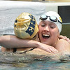 Thompson Valley's Eryn Eddy, right, congratulates Evergreen's Lexie Malazdrewicz swimming in the 100 yard freestyle during the state 4A girls swimming finals on Saturday at the Veterans Memorial Aquatic Center.<br /> February 9, 2013<br /> staff photo/ David R. Jennings