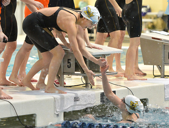 Thompson Valley's Eryn Eddy while still in the water is congratulated by teammates after finishing the 200 yard freestyle relay during the state 4A girls swimming finals on Saturday at the Veterans Memorial Aquatic Center.<br /> February 9, 2013<br /> staff photo/ David R. Jennings