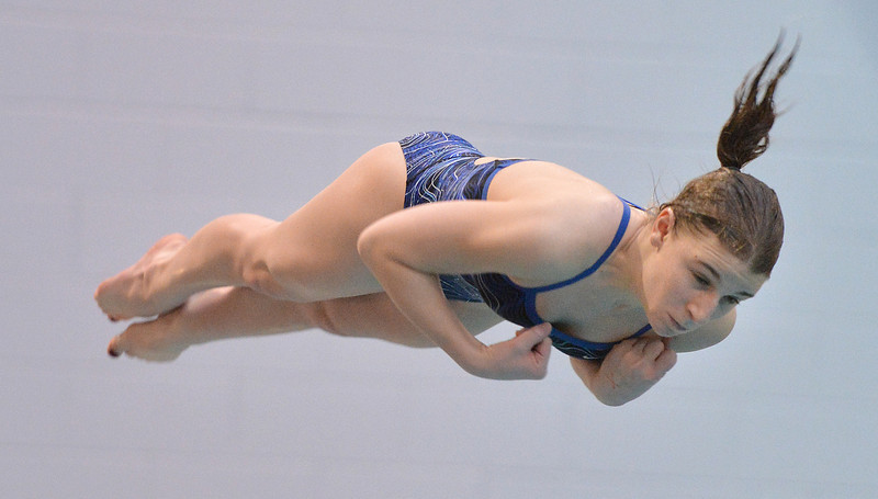 Broomfield's Melanie Stelling performs a dive during the state 4A girls swimming finals on Saturday at the Veterans Memorial Aquatic Center.<br /> February 9, 2013<br /> staff photo/ David R. Jennings