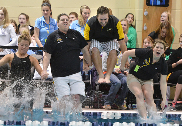 Thompson Valley coaches, from right, head coach Kayi Changstrom, Amon McCrary and Nathan Fristed jump into the pool after the team won the state 4A championship  on Saturday at the Veterans Memorial Aquatic Center.<br /> February 9, 2013<br /> staff photo/ David R. Jennings