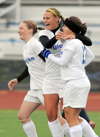 Broomfield's Kerri Marquardt, right, celebrates her goal against Evergreen with Hailey Mazzola and Kristin Snyder during the state 4A sweet 16 game at Elizabeth Kennedy Stadium on Friday. <br /> May 11, 2012 <br /> staff photo/ David R. Jennings