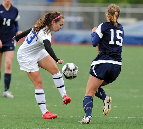 Broomfield's Kayla Snyder kicks the ball past Evergreen'sGracie Ventimiglia during the state 4A sweet 16 game at Elizabeth Kennedy Stadium on Friday. <br /> May 11, 2012 <br /> staff photo/ David R. Jennings