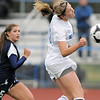 Broomfield's Courtney Miknis does a header to move the ball downfield past Evergreen's Katie Wilson during the state 4A sweet 16 game at Elizabeth Kennedy Stadium on Friday. <br /> May 11, 2012 <br /> staff photo/ David R. Jennings