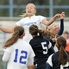 Broomfield's Morgan Rynearson jumps up to divert the ball to Kerri Marquardt to score a goal against Evergreen during the state 4A sweet 16 game at Elizabeth Kennedy Stadium on Friday. <br /> May 11, 2012 <br /> staff photo/ David R. Jennings