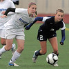 Broomfield's Kristin Snyder fights for control of the ball with Evergreen's Kylee Petrik during the state 4A sweet 16 game at Elizabeth Kennedy Stadium on Friday. <br /> May 11, 2012 <br /> staff photo/ David R. Jennings