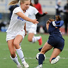 Broomfield's Morgan Rynearson breaks up a play against Evergreen's Jahna Pusedu during the state 4A sweet 16 game at Elizabeth Kennedy Stadium on Friday. <br /> May 11, 2012 <br /> staff photo/ David R. Jennings