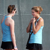 Rachel McClure, left, and Lynn Daniel, Centaurus chat between sets with Broomfield's Shivaun Wood and Monro Obenauer during the #1 doubles match on Thursday at Centaurus.<br /> April 5, 2012 <br /> staff photo/ David R. Jennings