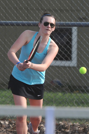 Rachel McClure, Centaurus returns the ball to Broomfield's Shivaun Wood and Monro Obenauer during the #1 doubles match on Thursday at Centaurus.<br /> April 5, 2012 <br /> staff photo/ David R. Jennings