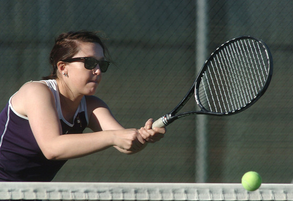 Legacy's no. 1 doubles player Muriel Westover returns the ball at the net during their match on Thursday against  Ft. Collins doubles team of Katie Dugan and Andrea Raab at Legacy.<br /> <br /> April 1, 2011<br /> staff photo/David R. Jennings